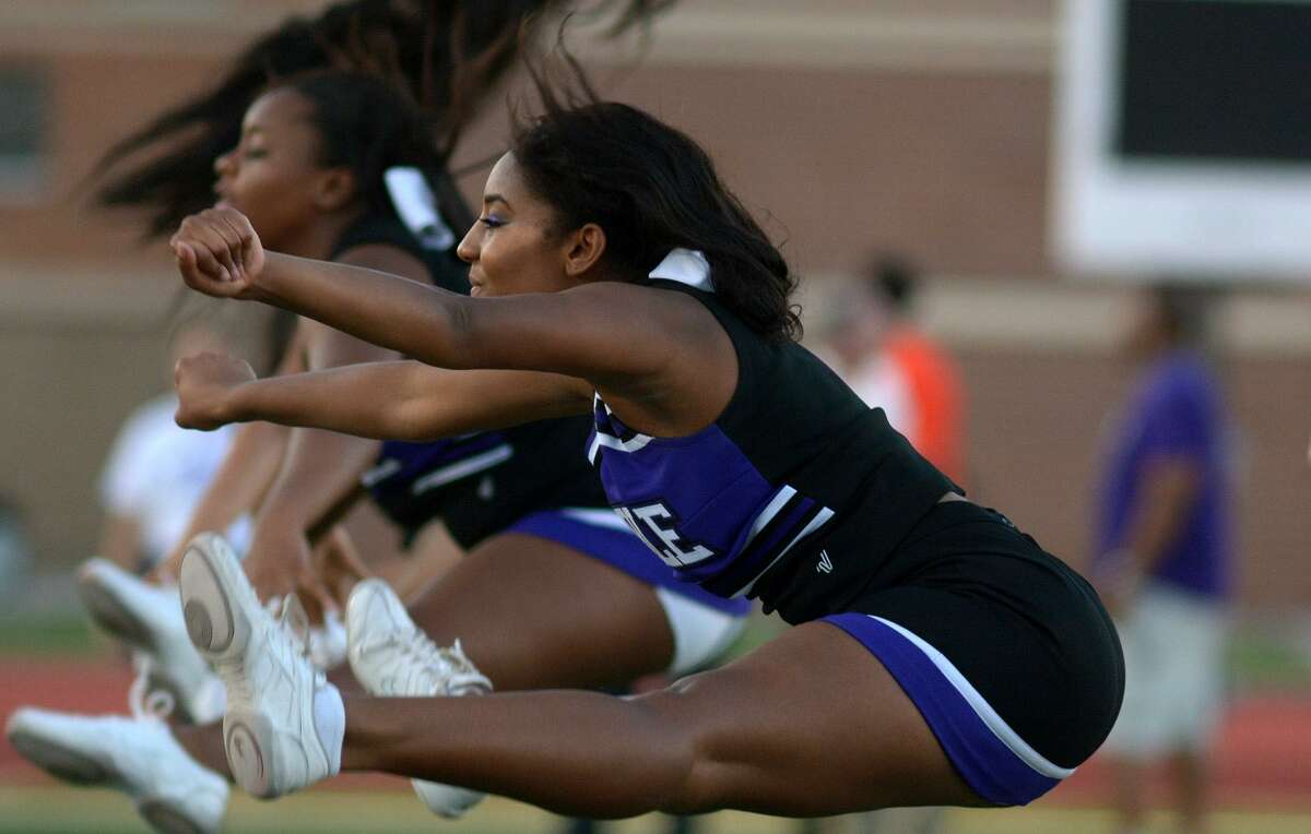 Humble High School junior and varsity cheerleader Alexandria Chambers, 16, works a team cheer during the HHS Homecoming Community Pep Rally in Turner Stadium on Sept. 14, 2016. (Photo by Jerry Baker/Freelance)