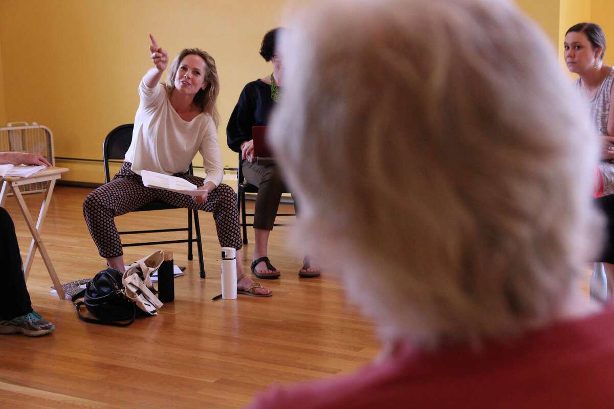 Tamara Hickey gestures toward Malcolm Ingram in a rehearsal for