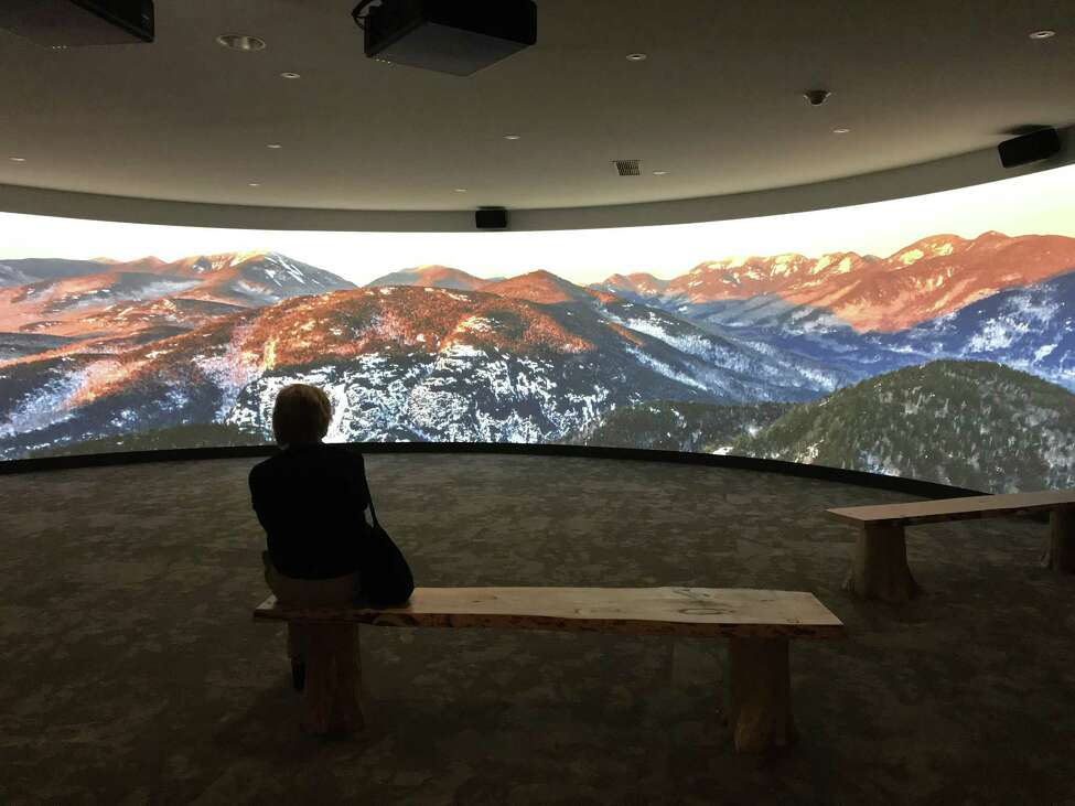 A woman watches a video at the Adirondack Experience in Blue Mountain Lake. (Amy Biancolli/Times Union)