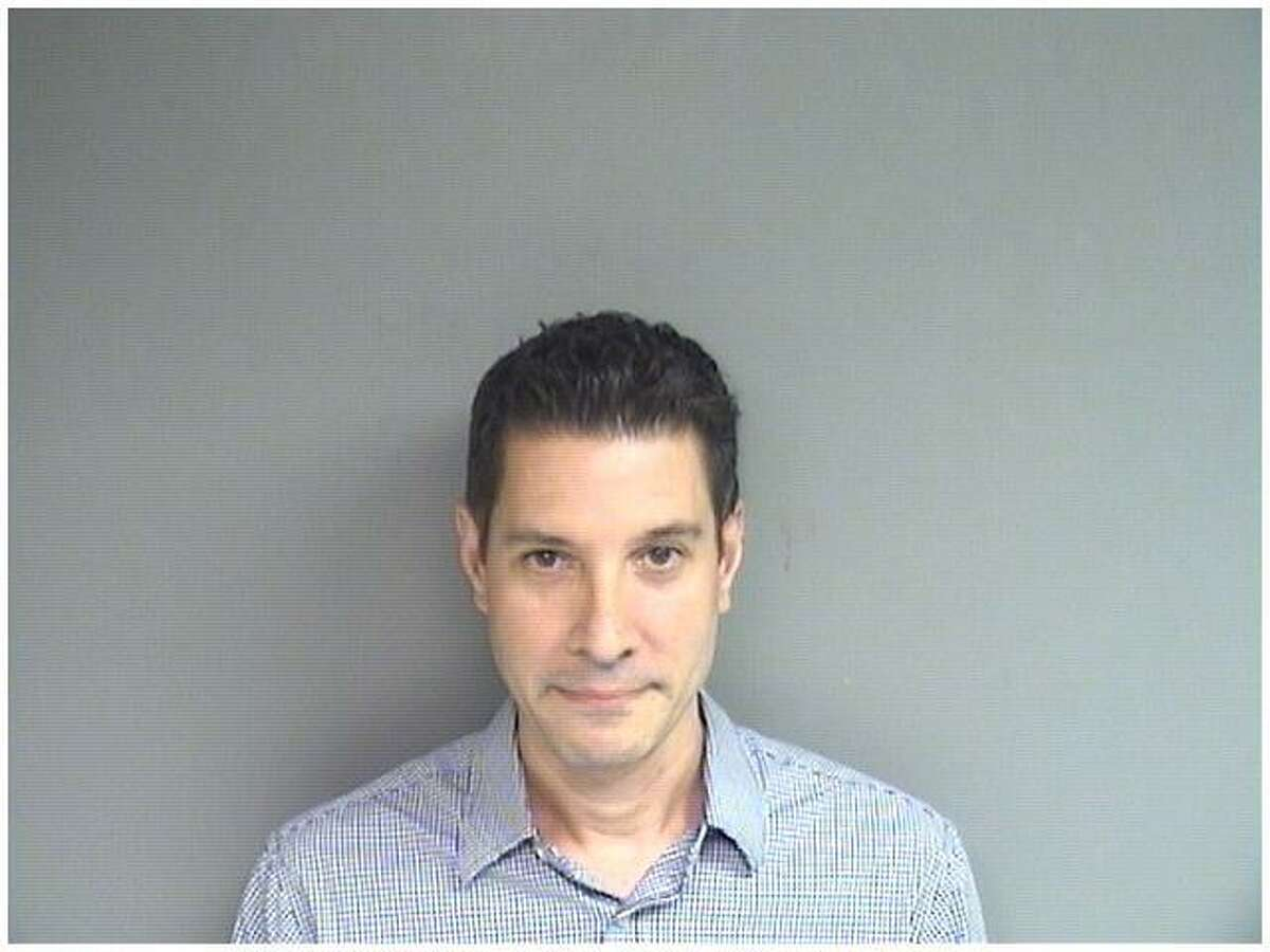 William Arana, 46, of Stamford, was charged Monday with 27 counts of voyeurism for allegedly using a spy camera in a cell phone charger to video tape people in the bathroom of his Courtland Avenue condo.