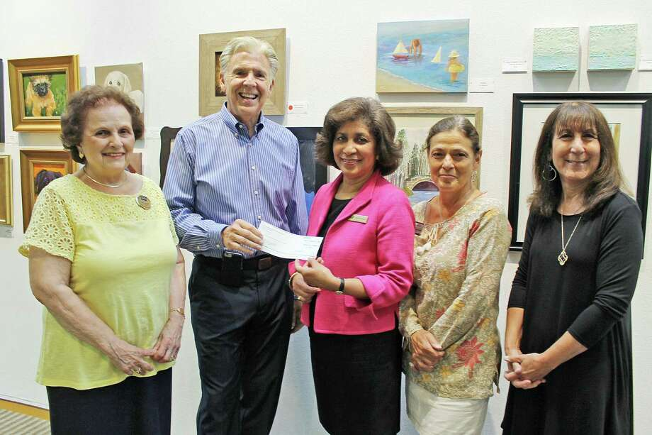 Twenty-five realtors from the Wilton Coldwell Banker office donated a portion of their commissioned earnings to Wilton Library's Annual Appeal. From left: Gail Cioffi of Coldwell Banker, Eric Weitz, manager of the Wilton office, Elaine Tai-Lauria, executive director of Wilton Library, Donna Nagy-Burzynski of Coldwell Banker and Robin Axness, development director of Wilton Library. The library relies on donations from individuals, businesses and organizations throughout the year to maintain the high quality of its materials, programs, and services the community has come to expect. Photo: Contributed Photo / Contributed Photo / Norwalk Hour contributed