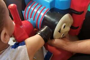 Danbury firefighters rescued a two-year-old boy Wednesday whose arm became stuck inside a Thomas the Tank Engine toy.