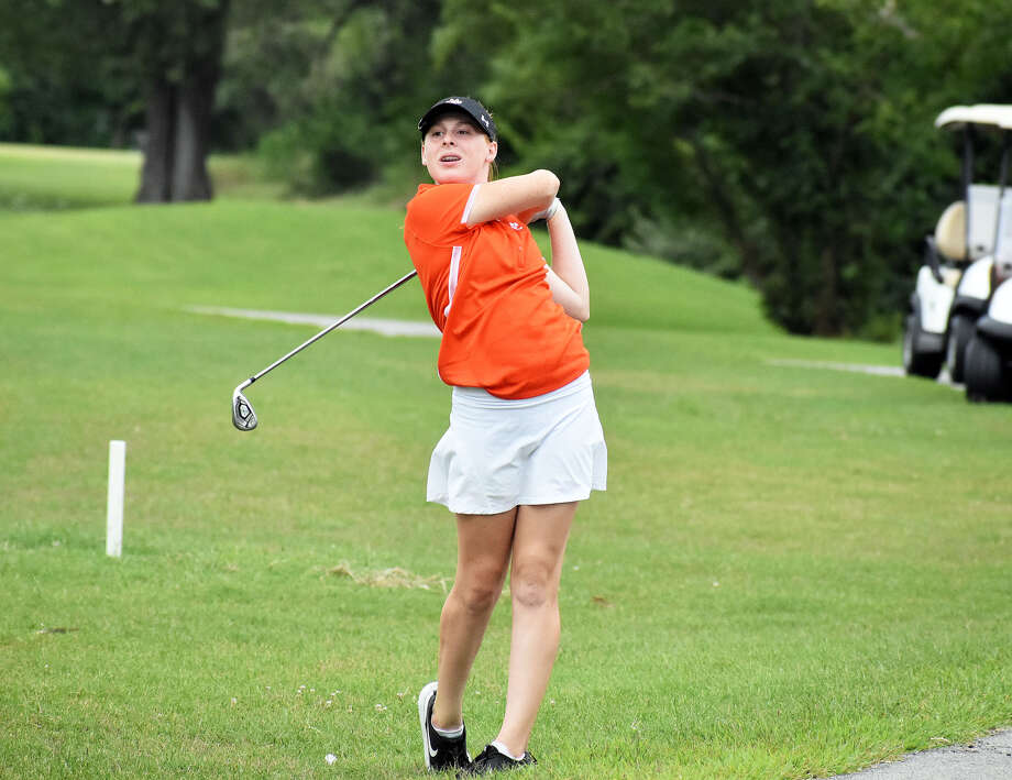 Edwardsville's Riley Lewis watches her approach shot during the Madison County Tournament. Photo: Matthew Kamp