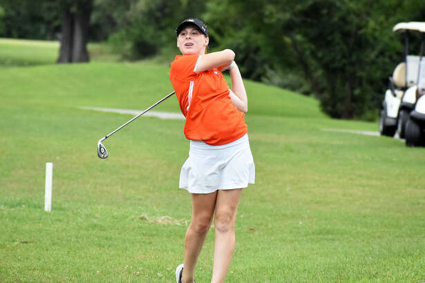 Edwardsville's Riley Lewis watches her approach shot during the Madison County Tournament.
