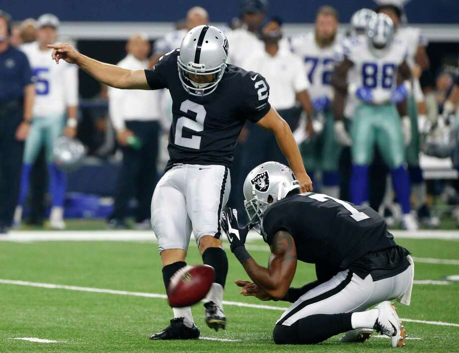 Oakland Raiders punter Marquette King (7) holds the ball as place kicker Giorgio Tavecchio (2) kicks an extra point in the first half of a preseason NFL football game against the Dallas Cowboys on Saturday, Aug. 26, 2017, in Arlington, Texas. The Texans auditioned veteran kickers Tavecchio and Nick Rose on Wednesday, according to league sources not authorized to speak publicly. Photo: Michael Ainsworth, AP / ONLINE_YES