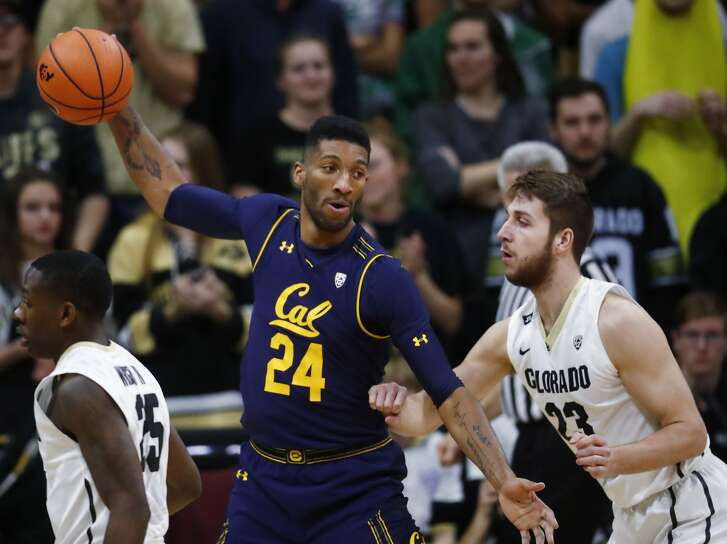 California forward Marcus Lee, left, looks to pass the ball as Colorado forward Lucas Siewert defends during the second half of an NCAA college basketball game Wednesday, Feb. 7, 2018, in Boulder, Colo. Colorado won 68-64. (AP Photo/David Zalubowski)