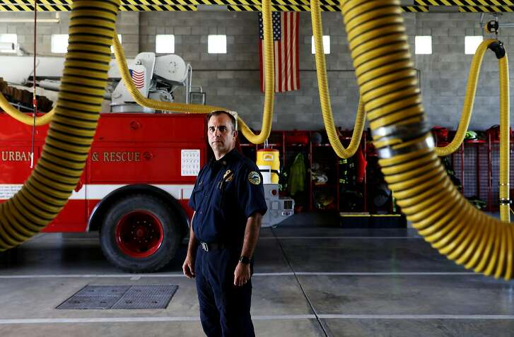 Deputy Chief Mark Brown, of the Marin County Fire Department, poses for a portrait at the Marin City Fire Department in Sausalito, Cali., on Thursday, August 2, 2018. Brown, 49, responded to the wildfires in SoCal and throughout the summer.