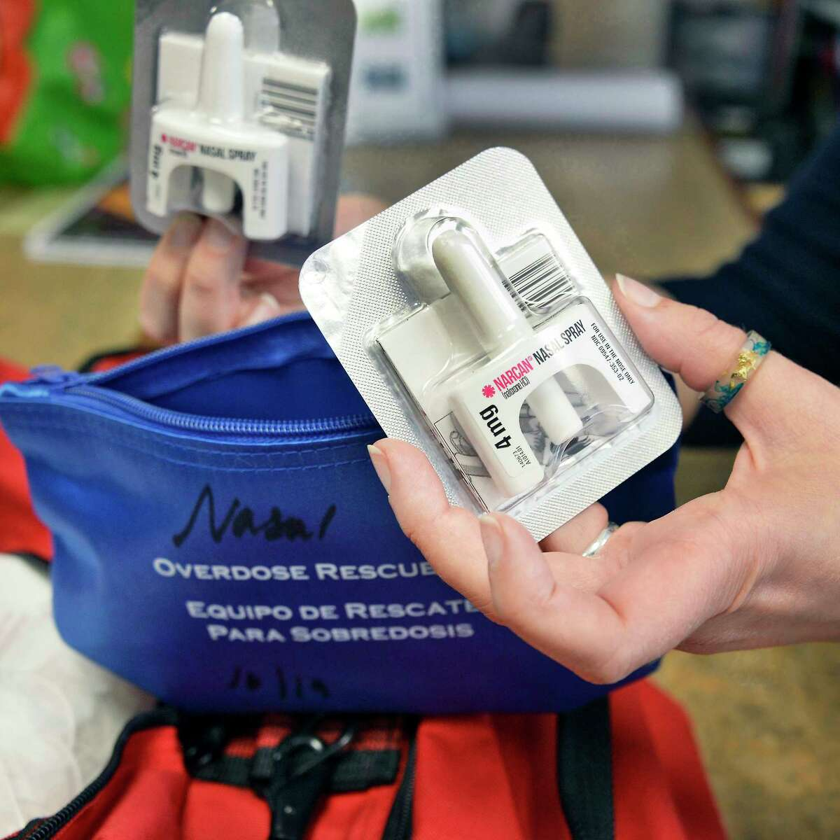 Albany Public Library assistant director Melanie Metger with a Narcan kit for drug overdoses in one of the emergency bags at the library's main branch Wednesday August 15, 2018 in Albany, NY. (John Carl D'Annibale/Times Union)