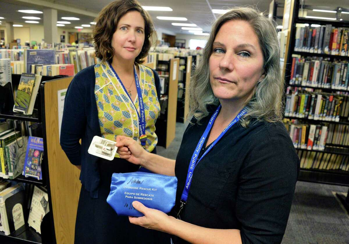 Albany Public Library assistant director Melanie Metger, left, and community services and support specialist Annie Johnson with a Narcan kit for drug overdoses kept in one of the emergency bags at the library's main branch Wednesday August 15, 2018 in Albany, NY. (John Carl D'Annibale/Times Union)