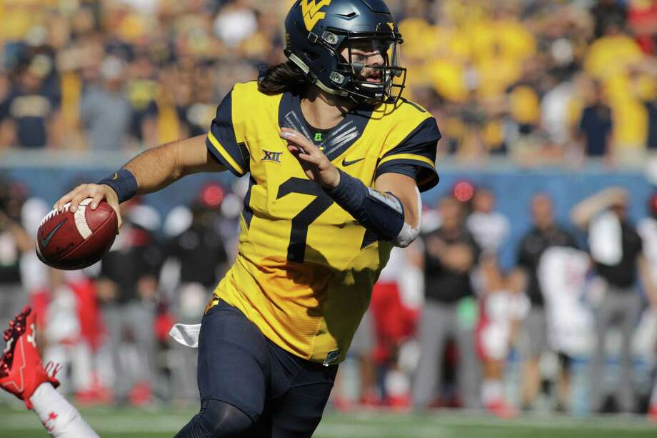 In this Oct. 14, 2017, file photo, West Virginia quarterback Will Grier (7) looks to pass against Texas Tech during an NCAA college football game in Morgantown, W.Va. While the Sooners are still the preseason favorite again, there are also high expectations for Grier, the preseason Big 12 offensive player of the year who threw 34 touchdowns and 3,490 yards in his injury-shortened WVU debut. Photo: Ray Thompson, FRE / Associated Press / FR171247 AP