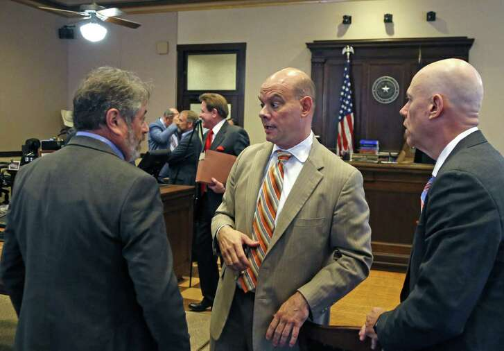 Chris D. Feldman, center, attorney representing the fire union talks with associates after the hearing on Wednesday, Aug.15, 2018. The Secure San Antonio's Future PAC will be in court to argue that a judge should toss out the petitions filed by the local fire union because, the PAC alleges, the fire union illegally funded the petition campaign.