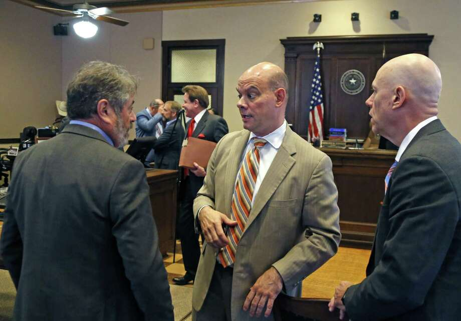 Chris D. Feldman, center, attorney representing the fire union talks with associates after the hearing on Wednesday, Aug.15, 2018. The Secure San Antonio's Future PAC will be in court to argue that a judge should toss out the petitions filed by the local fire union because, the PAC alleges, the fire union illegally funded the petition campaign. Photo: Ronald Cortes, Photo Correspondent / 2018 Ronald Cortes