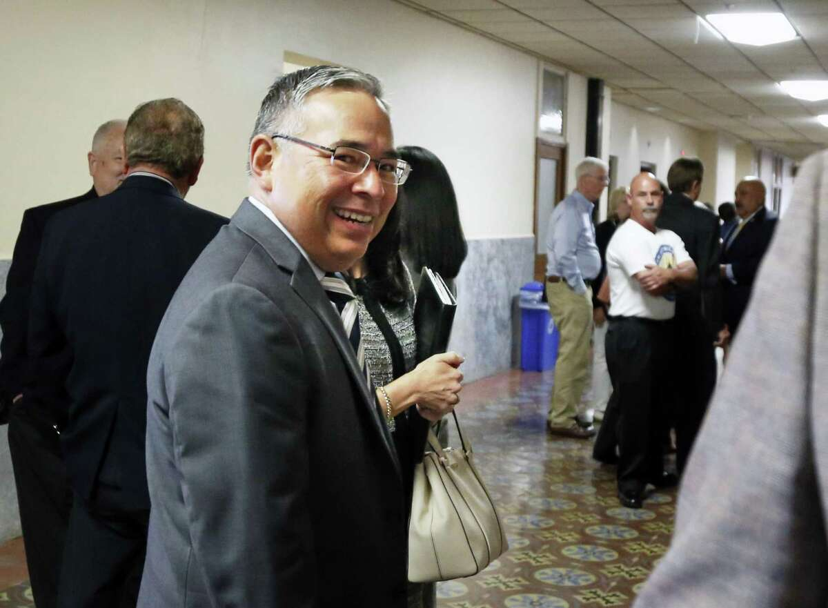 San Antonio City Attorney Andrew Segovia leaves the court room after the proceedings on Wednesday, Aug.15, 2018. The Secure San Antonio's Future PAC will be in court to argue that a judge should toss out the petitions filed by the local fire union because, the PAC alleges, the fire union illegally funded the petition campaign