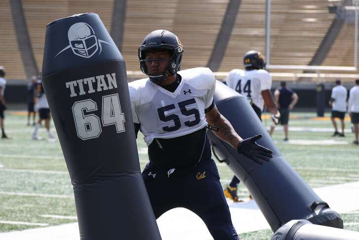 Cal defensive lineman Lone Toailoa practices his pass-rushing moves during training camp.