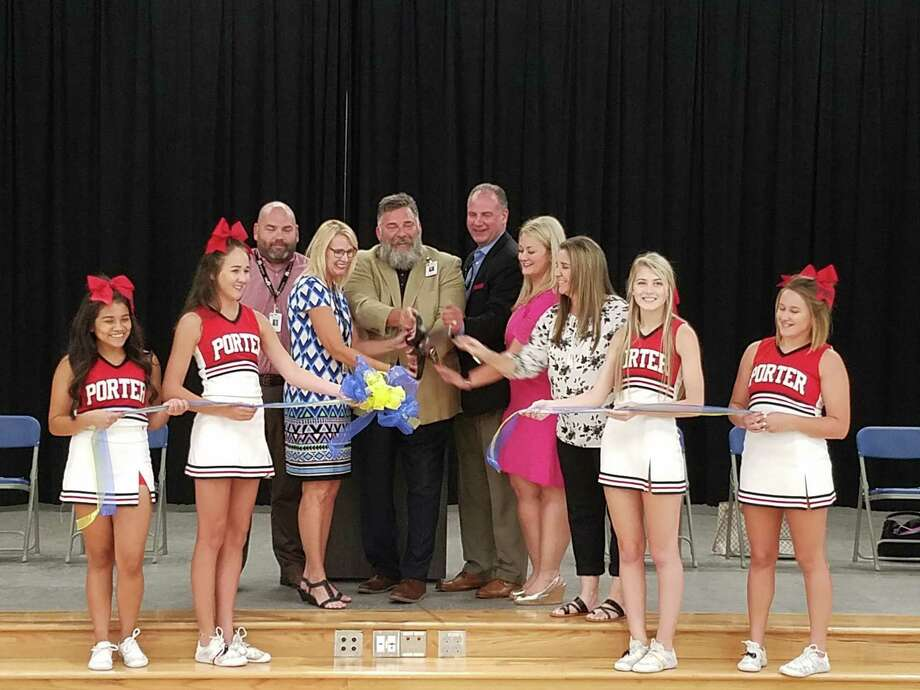 New Caney ISD board members and Porter High School cheerleaders celebrated the opening of Brookwood Forest Elementary with a ribbon-cutting ceremony and tours of the school on Tuesday, Aug. 14, 2018. Photo: Jennifer Summer