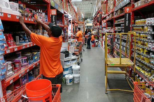 In this Tuesday, Aug. 14, 2018, photo workers stock the shelves at a Home Depot store in Passaic, N.J. (AP Photo/Ted Shaffrey)