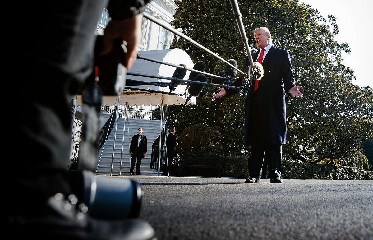 FILE -- President Donald Trump takes questions from reporters outside the White House, in Washington, March 13, 2018. More than 200 newspapers, including The New York Times, have committed to publishing editorials on the same day � Aug. 16, 2018 � on the dangers of the Trump administration�s assault on the press. (Tom Brenner/The New York Times)