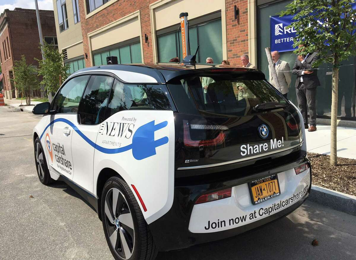 A plug-in electric vehicle and charging station at The News Apartments was unveiled on Wednesday, Aug. 15, 2018, in Troy, N.Y. The BMW i3 marks the first plug-in electric vehicle in Capital CarShare?•s shared fleet. (Eric Anderson/Times Union)