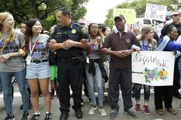 Houston Police Chief Art Acevedo, Mayor Sylvester Turner and Congresswoman Sheila Jackson Lee stand arm-in-arm-with students as they began the march to Senator Ted Cruz's office during the March for Our Lives protest and march starting at Tranquility Park, Saturday, March 24, 2018, in Houston. After the recent mass shooting at Stoneman Douglas, students of the school have organized a nationwide protest including Houston, TX to plea for a strengthening of gun laws. ( Karen Warren / Houston Chronicle )