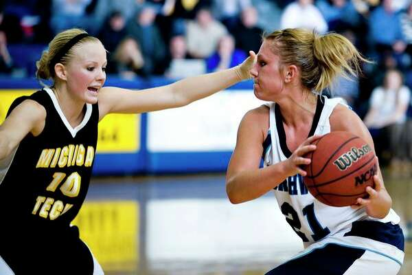 Northwood's Pam Wilson is defended by Michigan Tech's Tara Ferris in a 2009 game. (Daily News file photo)