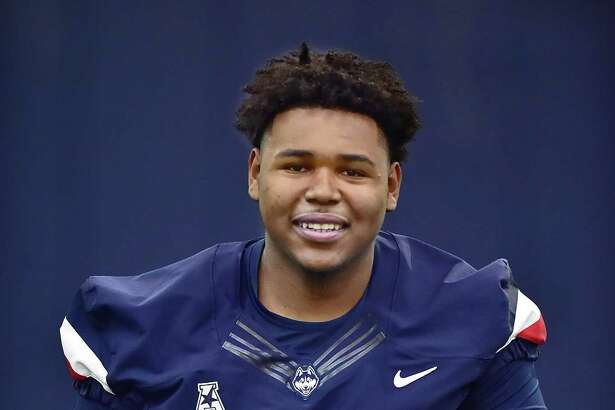 No true freshman has opened more eyes than former Wilbur Cross lineman Travis Jones, who is vying for a starting spot on the UConn football team.