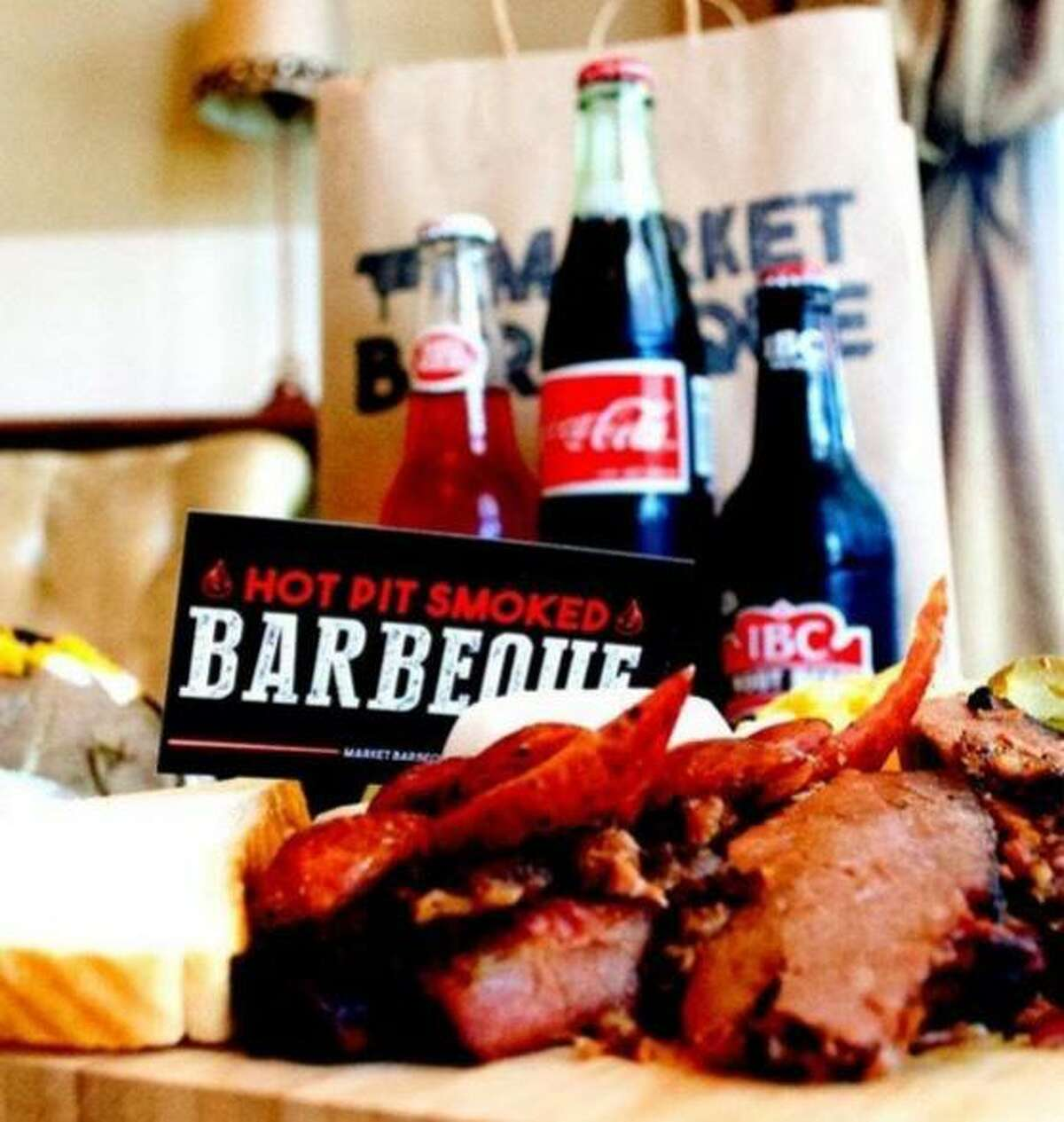Hoppin' John owners April Carter and Guillermo Galvan will open Market Barbecue near the Brooks development in October.