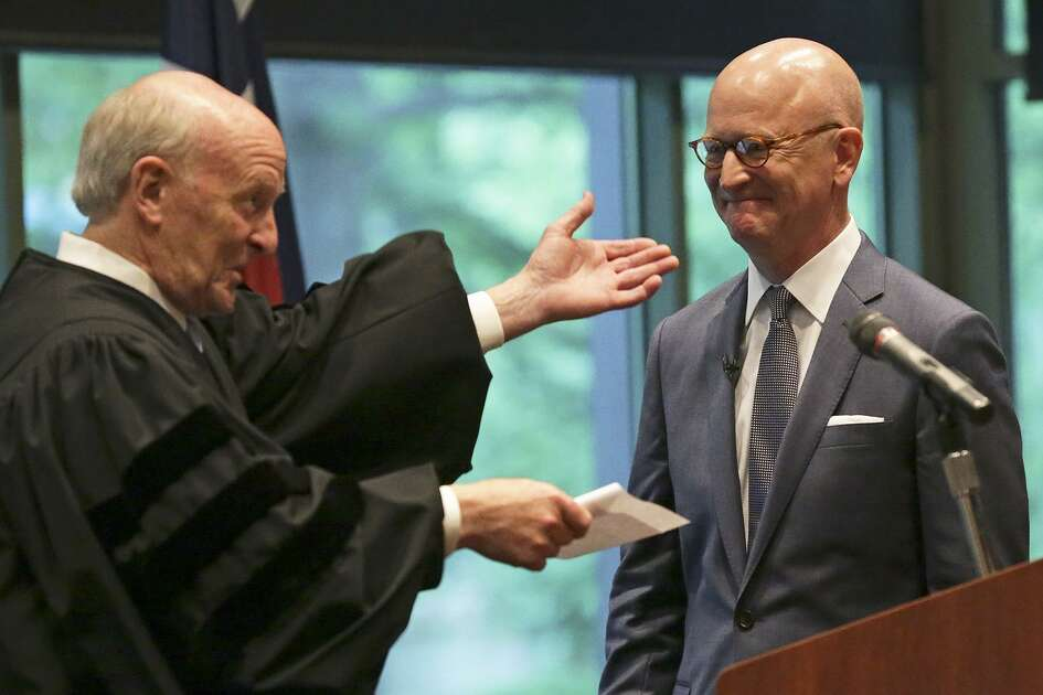 In this 2015 photo, U.S. District Judge Fred Briery (left) presents U.S. District Judge Robert Pitman following a swearing in ceremony. Biery is presiding over a rancorous civil case involving Quicken Loans and HouseCanary. HouseCanary won a record $706 million jury verdict against a Quicken Loan affiliate early this year in Bexar County.