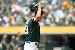 OAKLAND, CA - AUGUST 15: Matt Olson #28 of the Oakland Athletics reacts after striking out against the Seattle Mariners in the bottom of the fourth inning at Oakland Alameda Coliseum on August 15, 2018 in Oakland, California. (Photo by Thearon W. Henderson/Getty Images)