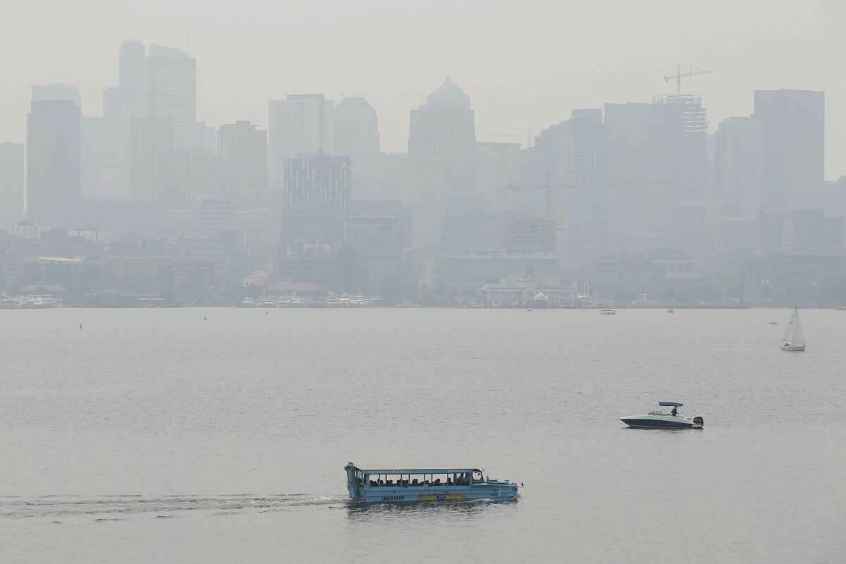 A Ride the Ducks boat crosses Lake Union as wildfire smoke causes a thick haze over the Seattle skyline and unhealthy air quality levels, Wednesday, Aug. 15, 2018.