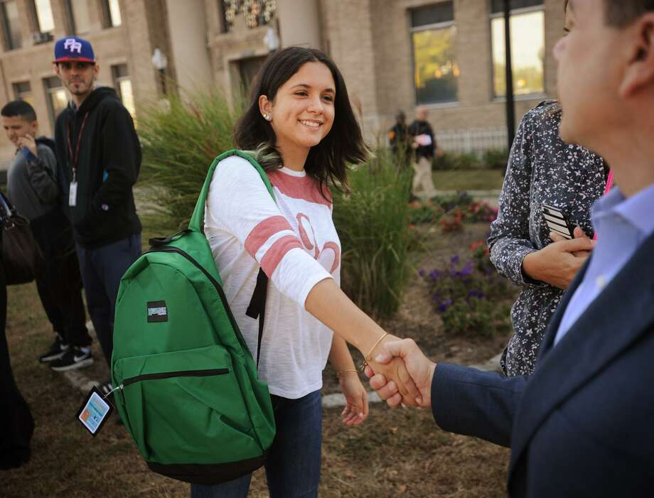 Maria Marrero, 17, from Carolina, Puerto Rico, shakes hands with Bridgeport Mayor Joe Ganim after receiving a school backpack outside City Hall in Bridgeport, Conn. on Thursday, October 5, 2017. Marrero will be attending Bassick High School. Photo: Brian A. Pounds / Hearst Connecticut Media / Connecticut Post