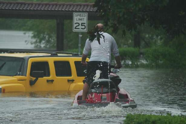 A rescue volunteer rides a personal water craft as residents are evacuated off FM 518 near Bay Area Boulevard during Hurricane Harvey flooding. Houston District E City Councilman Dave Martin supports a Harris County bond package on the Aug. 25 ballot, saying it would fund projects to ease area flood risks.