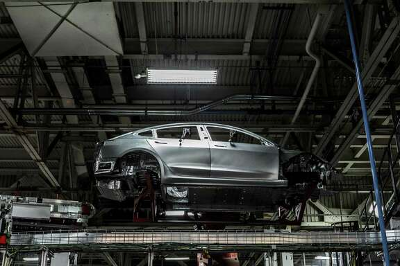 A Model 3 on the body line at Tesla's factory in Fremont, Calif., June 14, 2018. Tesla announced on Aug. 14 that three independent board members would supervise any potential proposal by the chief executive, Elon Musk, to take the automaker private.