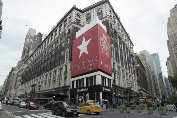 In this May 16, 2018, file photo, traffic makes its way past the Macy's flagship store in New York. Macy's Inc. reported earnings Wednesday, Aug. 15.