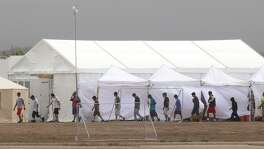 "Immigrant kids walk through the C.B.P. facility where the newly formed ""tent city"" is located, Saturday, June 16, 2018, in Tornillo. Photo by Ivan Pierre Aguirre/ for the San Antonio Express-News"