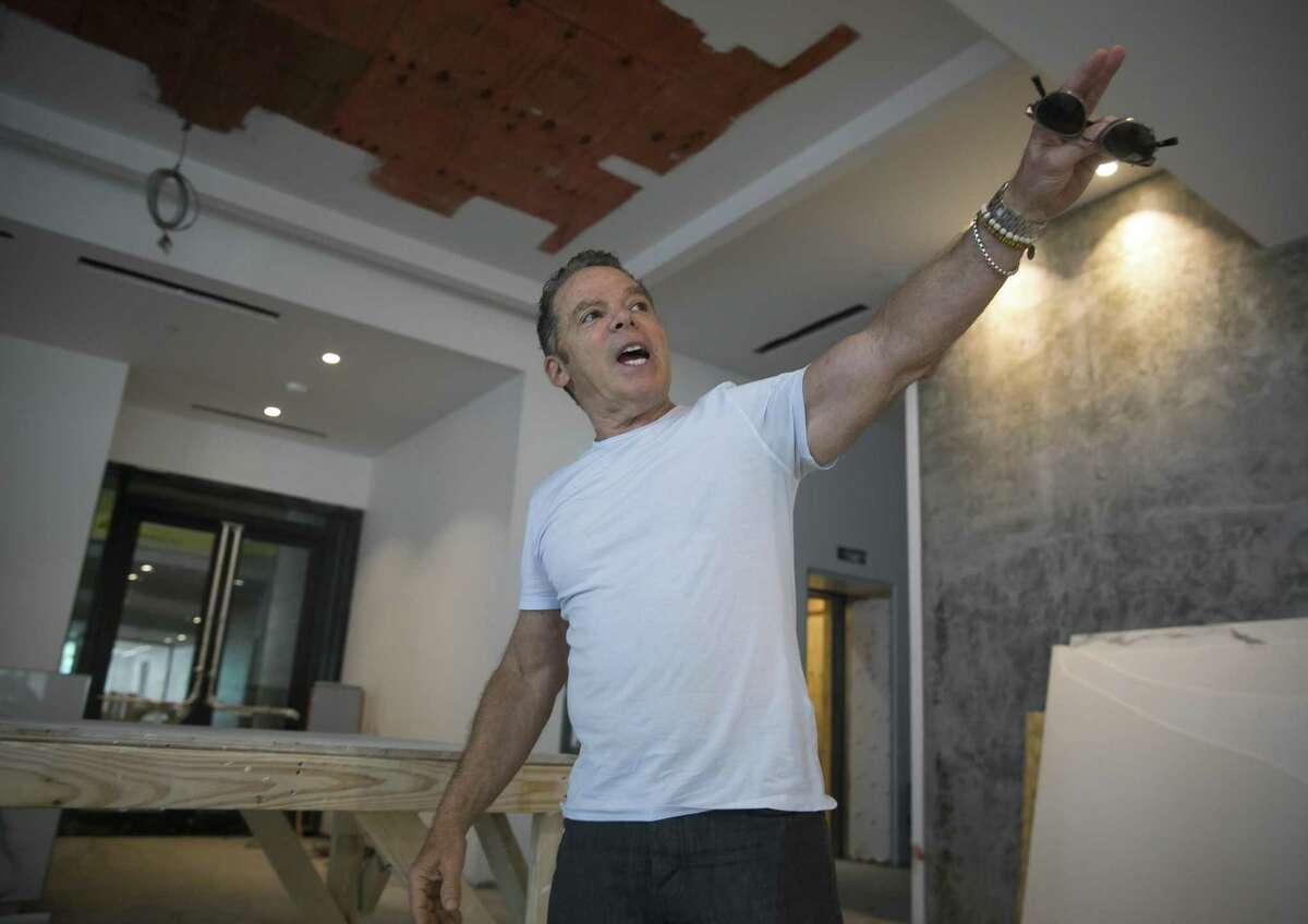 Randall Davis points out where different art installations will be in the lobby of the new Marlowe development in downtown Houston on Wednesday, Aug. 15, 2018.
