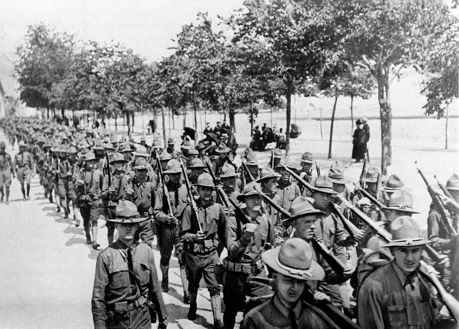 U.S. troops of the 1st Division, the first American troops to land on French soil, parade in St. Nazaire, France, June 26, 1917 during World War I. A reader says President Trump's plan for a far grander parade in the U.S. now is too costly. Photo: /AP / 1917 AP
