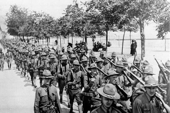 U.S. troops of the 1st Division, the first American troops to land on French soil, parade in St. Nazaire, France, June 26, 1917 during World War I. A reader says President Trump's plan for a far grander parade in the U.S. now is too costly.