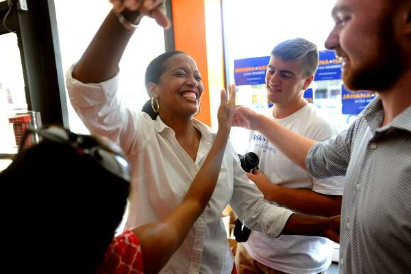 Jahana Hayes is hugged by her student campaign volunteers as she arrives at her campaign headquarters in Waterbury, Conn. on Wednesday, August 15, 2018. Hayes won the Democratic primary for Connecticut's 5th District House of Representatives seat.