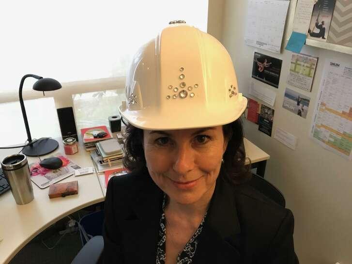Artistic Director Celia Fushille models her bejeweled hard hat.