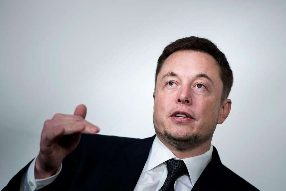 """In this file photo taken on July 19, 2017, Elon Musk, CEO of SpaceX and Tesla, speaks during the International Space Station Research and Development Conference at the Omni Shoreham Hotel in Washington, DC. - Shares of Tesla fell Wednesday, August 15, 2018, following reports US securities regulators have subpoenaed the electric car maker's Chief Executive Elon Musk over his statements about taking the company private. Shares finished down 2.6 percent at $338.69 after news of the formal demand for information was published by Fox Business and The New York Times. Shares fell as much as 4.5 percent earlier in the session. The development suggests the oversight by the US Securities and Exchange Commission -- which was characterized in previous news articles as an inquiry -- has """"advanced to a more formal, serious stage,"""" said The Times, which cited a person familiar with the matter. Photo: Brendan Smialowski / AFP / Getty Images 2017"""