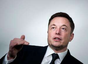 """(FILES) In this file photo taken on July 19, 2017, Elon Musk, CEO of SpaceX and Tesla, speaks during the International Space Station Research and Development Conference at the Omni Shoreham Hotel in Washington, DC. - Shares of Tesla fell Wednesday, August 15, 2018, following reports US securities regulators have subpoenaed the electric car maker's Chief Executive Elon Musk over his statements about taking the company private. Shares finished down 2.6 percent at $338.69 after news of the formal demand for information was published by Fox Business and The New York Times. Shares fell as much as 4.5 percent earlier in the session. The development suggests the oversight by the US Securities and Exchange Commission -- which was characterized in previous news articles as an inquiry -- has """"advanced to a more formal, serious stage,"""" said The Times, which cited a person familiar with the matter. (Photo by Brendan Smialowski / AFP)BRENDAN SMIALOWSKI/AFP/Getty Images"""