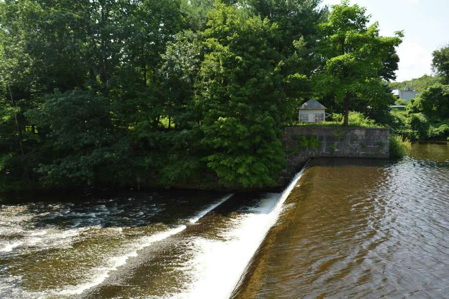 The Coe Brass Dam, built circa 1904. A historic gate house on the far bank is being renovated. Photo: Leslie Hutchison / Hearst Connecticut Media /