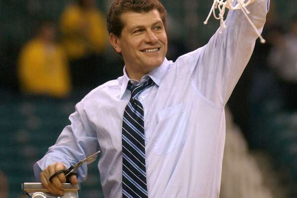 UConn coach Geno Auriemma cuts down the net after his team defeated Tennessee in the 2003 NCAA championship game.