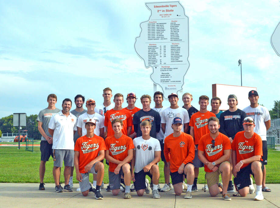 Members of the 2017 Edwardsville baseball team gathered Thursday night at Tom Pile Field for the dedication of a new sign honoring the team, which finished second in Class 4A. The sign was paid for by donations from the EHS Baseball Booster Club, Brickman Orthodontics, alumni and coaches. It joins signs from 1990 (first place in Class AA), 1991 (second in Class AA), 1998 (first in Class AA) and 2002 (second in Class AA). Photo: Scott Marion