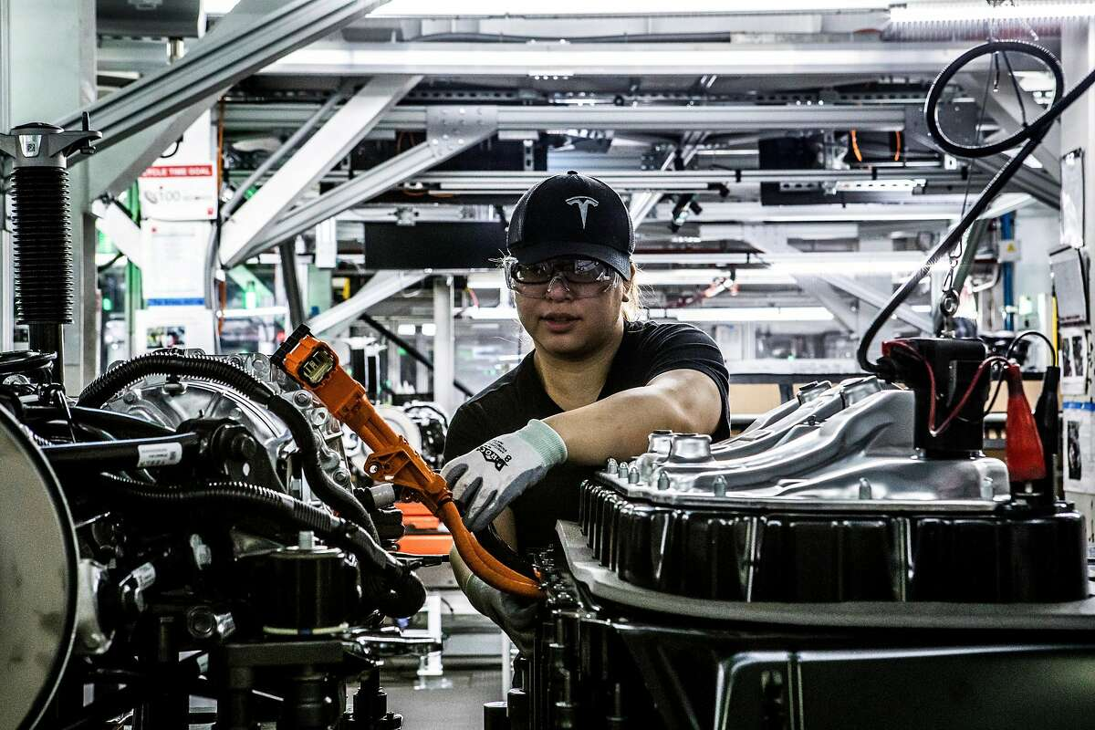 FILE -- A worker on the Model 3 assembly line where the marriage of the battery and car take place at the Tesla factory in Fremont, Calif., June 14, 2018. The Tesla CEO remains up in his fight with those betting on a fall in the electric carmaker's shares. But his doubters remain undeterred. (Christie Hemm Klok/The New York Times)