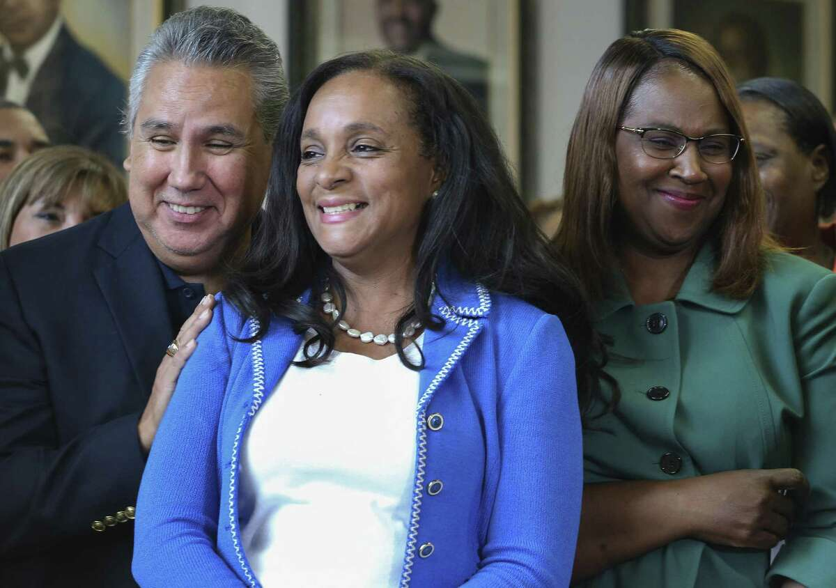 Houston ISD Board of Trustees member Sergio Lira, from left, board president Rhonda Skillern-Jones and HISD Superintendent Dr. Grenita Lathan cheer for the district during a press conference at WHS to celebrate the District's achievement at the academic accountability ratings on Wednesday, Aug. 15, 2018, in Houston. Worthing was one of four HISD schools that must meet state academic standards this year to avoid triggering forced campus closures or a state takeover of the district's locally elected school board, and all four schools passed.