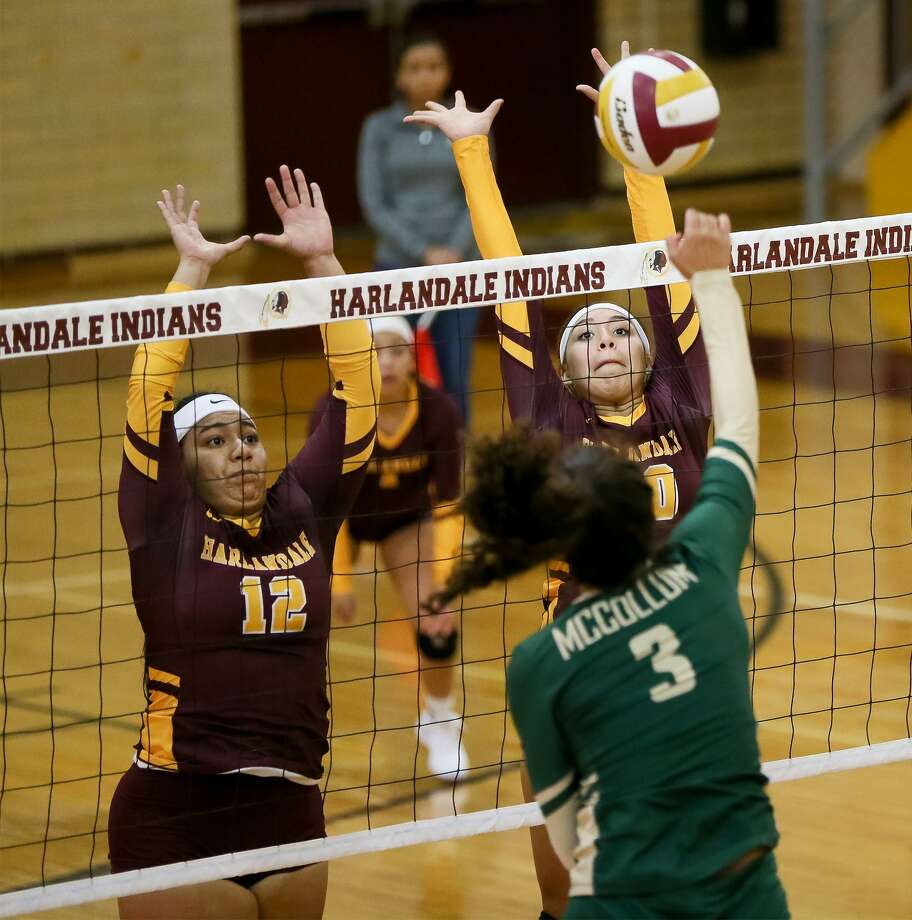 Harlandale's Serina Hernandez (right) and Alfarah Navarro try to block a shot by McCollum's Bryanna Rich during the finals of the 2018 Harlandale ISD Invitational Volleyball Tournament on Saturday, Aug. 11, 2018. Harlandale defeated McCollum in two sets, 25-21 and 25-15, to claim the championship. Photo: Photos By Marvin Pfeiffer / San Antonio Express-News / Express-News 2018