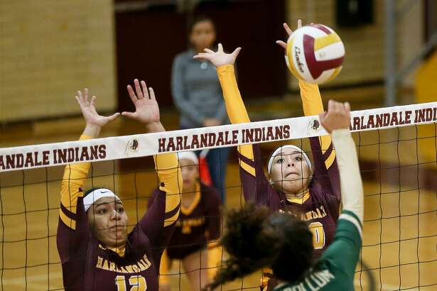 Harlandale's Serina Hernandez (right) and Alfarah Navarro try to block a shot by McCollum's Bryanna Rich during the finals of the 2018 Harlandale ISD Invitational Volleyball Tournament on Saturday, Aug. 11, 2018. Harlandale defeated McCollum in two sets, 25-21 and 25-15, to claim the championship.