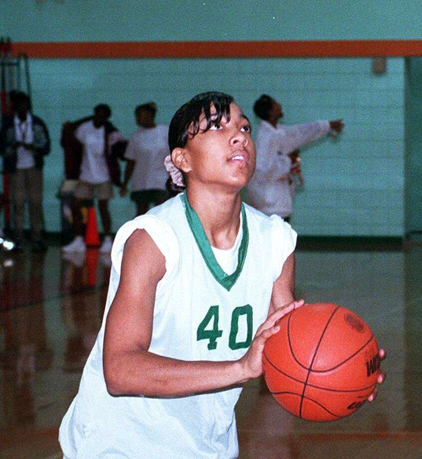 Tai Dillard Sam Houston HS outstanding basketball player shoots a basket Photo: Staff File Photo