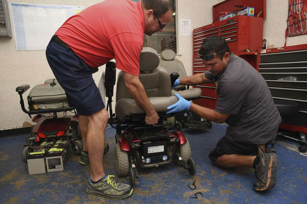 Joe Talamantez, left and Mario Ochoa disassemble a donated power chair to refurbish it at Project MEND on Wednesday, Aug. 15, 2018. Project MEND provides refurbished medical equipment and assistive technology to people with disabilities who cant afford the equipment or are without items because of denied insurance coverage.